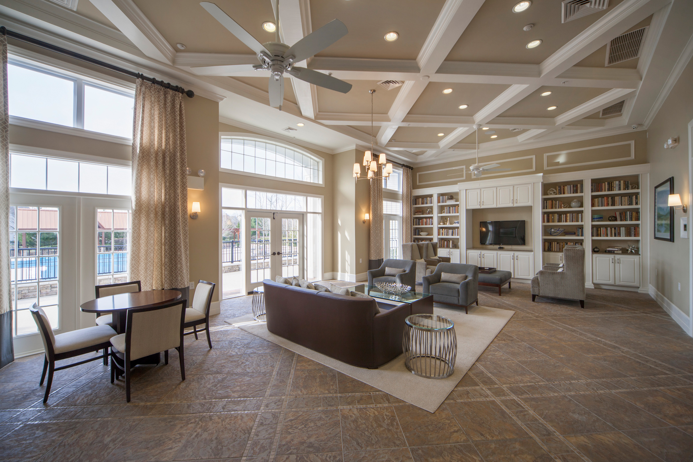 The clubhouse with contemporary decor, high ceilings, and natural light.